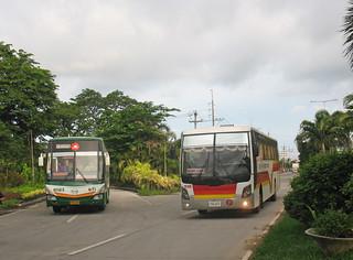 38408 (874) 08-07-2014 of Baliwag Transit Inc. Hino CXU-127 (fleet No 8923) and Victory Liner 036410 (fleet No 1549) Northern Expressway near McArthur Highway Bridge, Tabang, on the Tabang Spur, Bulacan, Philippines.