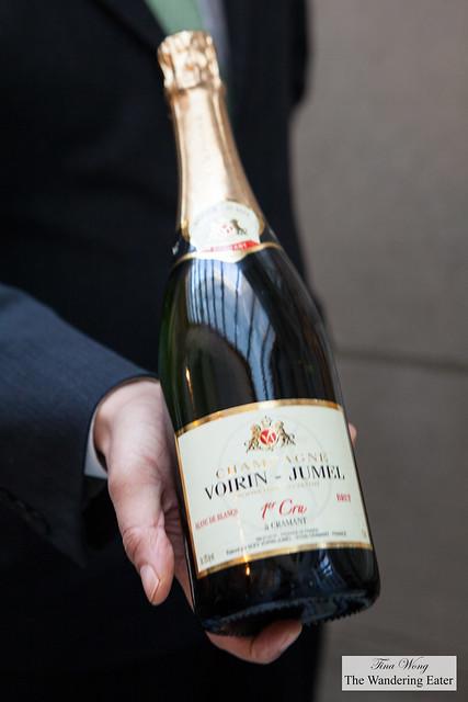 Our server showing us our bottle of Champagne Voirin-Jumel 1st Cru Blanc de Blancs