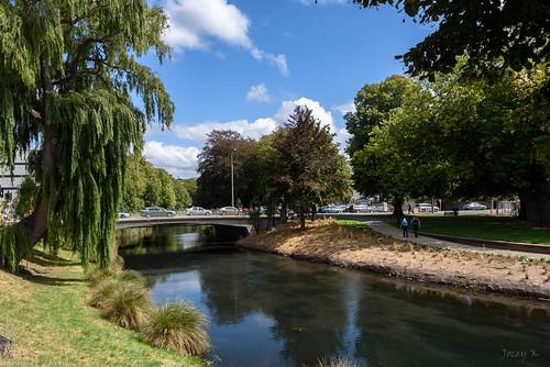 newzealand southisland christchurch cbd buildings shadows trees sky clouds water river avon avonriver earthquakememorialsite