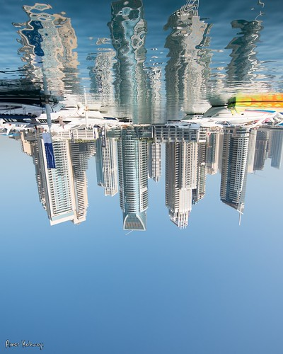 blue sky reflection building water up high dubai side down