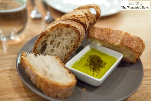 Sliced country bread and seasoned olive oil to dip