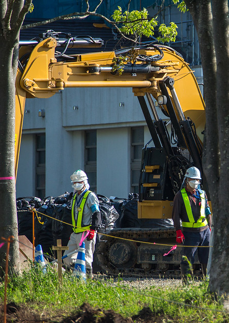 Workers remove top soil contaminated by nuclear radiations after the daiichi nuclear power plant explosion, Fukushima prefecture, Iitate, Japan