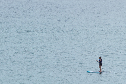 ocean blue sea woman alone quiet board fear paddle northcarolina outerbanks courage expanse paddleboard