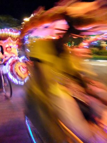 Decorated Rickshaw on the Move in Melaka, Malaysia