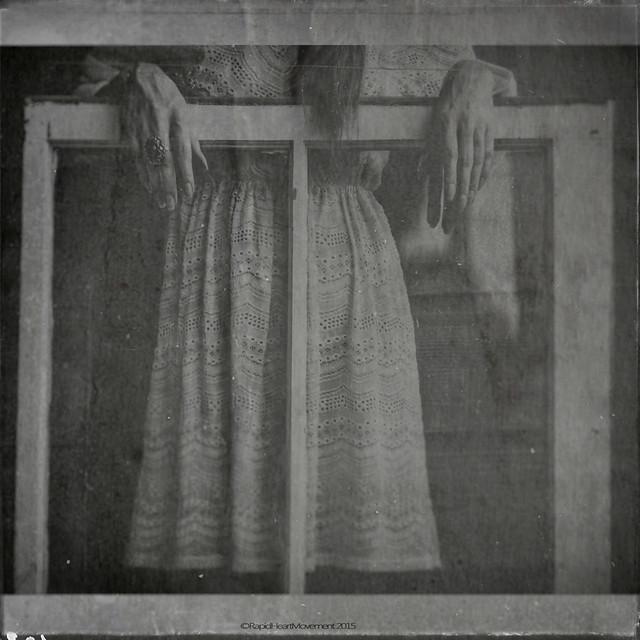 In a shabby window of an earthly street
