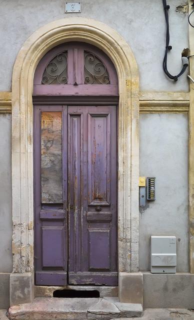Mauve damaged door and wirework