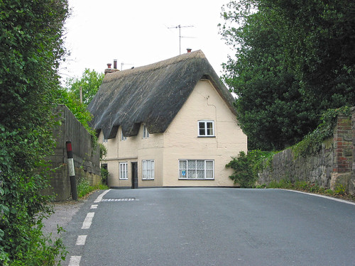 Thatched cottage blocking the A360 road   by Polyrus