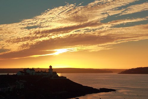 ocean sunset sky lighthouse silhouette clouds sunrise point dawn dusk cork roches