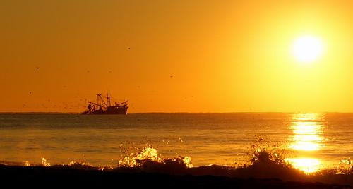 ocean beach sunrise northcarolina shrimpboat topsailbeach
