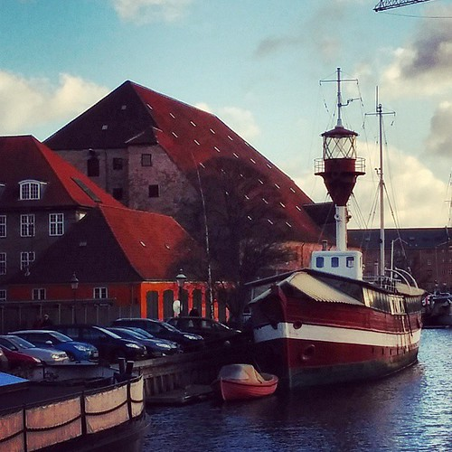 A lighthouse boat in front of Chrisitian IV's Brewery (the largest tiled roof in northern Europe) in Copenhagen. | by Sunfox