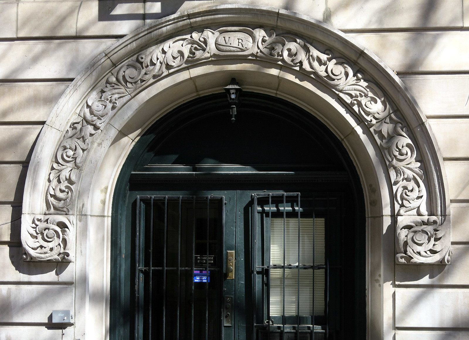 Doorway with a rounded carved pediment, 17-19 East 11th Street (1901), Greenwich Village, Manhattan