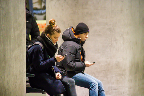 People with phones at the station - texting | by Infomastern
