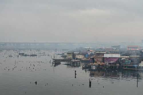 poverty life africa people house water trash river living smog dangerous community families culture lagos safety crime pollution nigeria shanty disease slum congestion pirogue crowded dugoutcanoe disparity westernafrica makoko