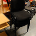 Black fabric stacking chair