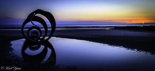 ngc blue oramge sculpture sea ocan warwe reflection water blackpool england travel touris attraction tourist sunset cloudsstormssunsetssunrises