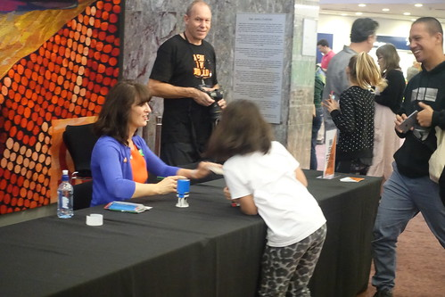 Liz Pichon signs something for a young fan