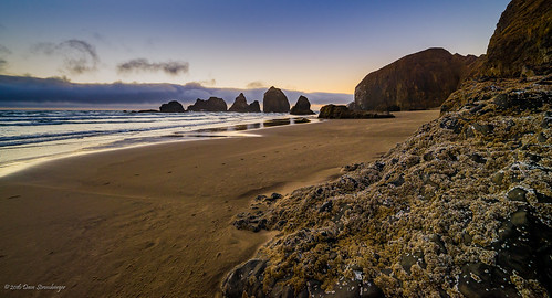 ocean sunset sea beach water clouds oregon golden us sand rocks unitedstates tillamook oceanside hour stacks