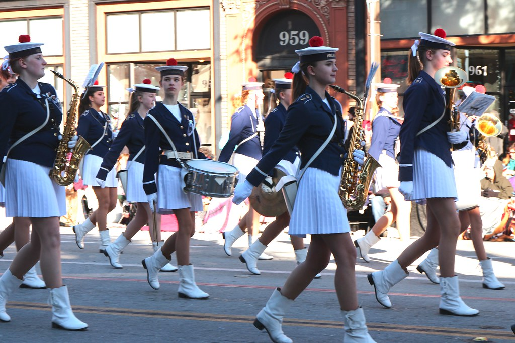 Pigtailed brunette in a marching band get