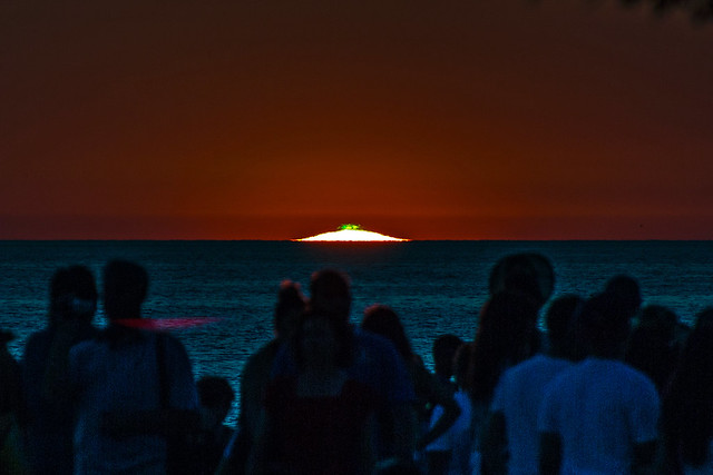 People watching the green flash at the end of a sunset in Zadar
