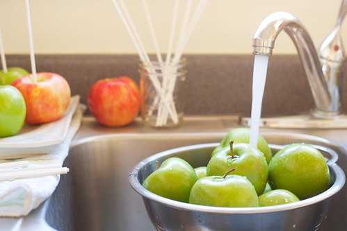 washing apples with water in a sink | by PersonalCreations.com