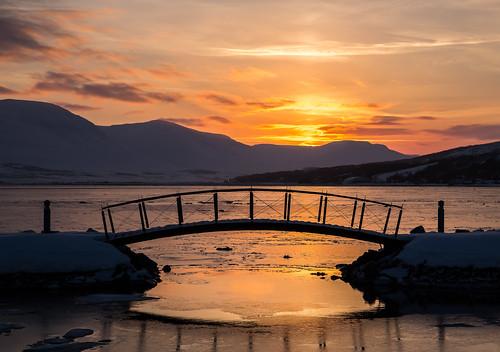 bridge winter sunset sky sun mountain mountains nature water sunrise iceland akureyri strandgata littlebridge northiceland