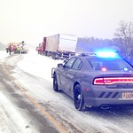 February 2, 2016 - 16:54 - A Portage County (Wisconsin) Sheriff's Office squad stands guard over a semi-truck that slid off the highway during a late winter storm.