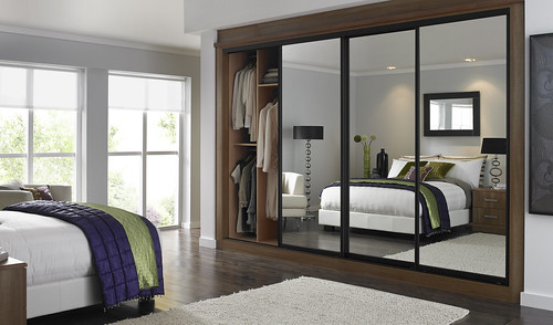 Bedroom with a mirrored fitted wardrobe | by BettaLivingUK