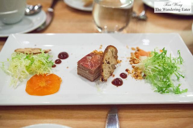 Foie gras millefeuille, persimmon, Serrano ham, pink peppercorn, and hazelnut crumble