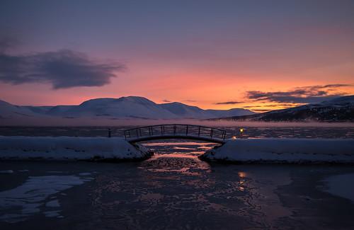 bridge winter light red sea sky sun snow colors clouds landscape iceland december akureyri littlebridge pollurinn