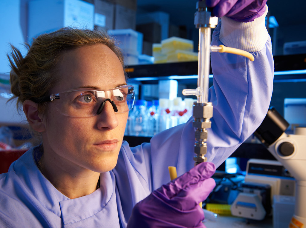 Dr. Ellis using a bioreactor in a lab.