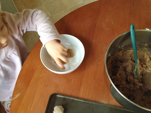 rolling gingersnaps in sugar | by betondinner