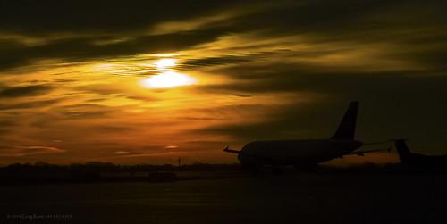 silhouette sunrise sunrises flight aviation orange yellow cloud clouds dawn kclt charlottedouglasinternationalairport