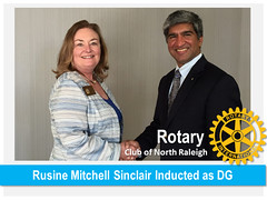 """The torch was passed from Newman Aguiar to Rusine Sinclair Wednesday night at the North Raleigh Country Club. See more at <a href=""""http://northraleighrotary.org/rusine-mitchell-sinclair-inducted-as-2016-17-district-governor/"""" rel=""""nofollow"""">northraleighrotary.org/rusine-mitchell-sinclair-inducted-...</a>"""