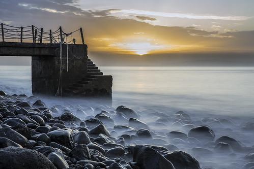 sunrise pier pebbles pebblebeach madeira longexposurephotography canicodebaixo 10stopfilter canon5dmkiii 2geephotography