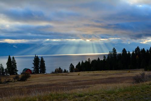 lake clouds sunrise dawn montana sunrays flathead