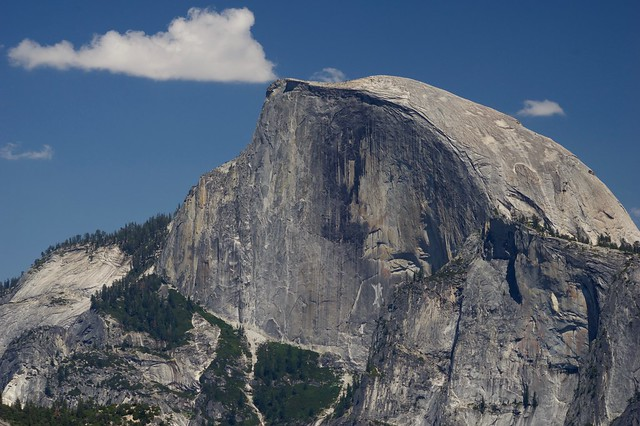 Half Dome and half cloud