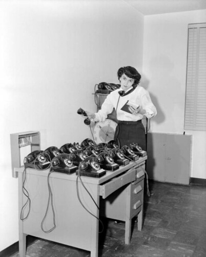 Mrs. Red Taylor with desk full of phones - Tallahassee | by State Library and Archives of Florida