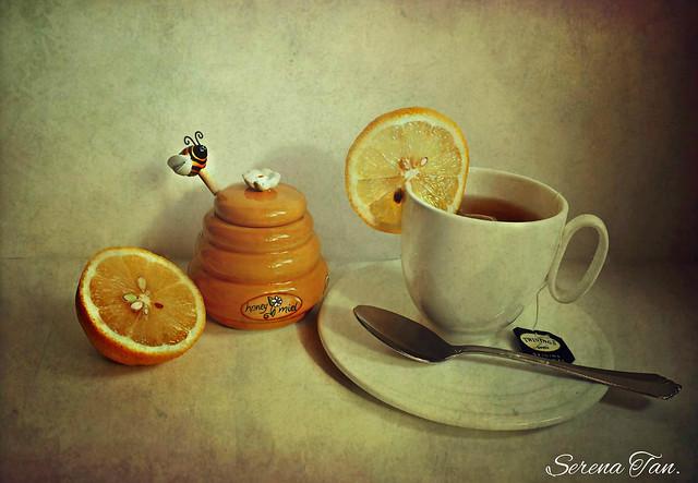 A cup of tea with honey & lemon