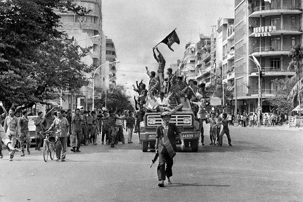 17 April 1975 - Khmer Rouge fighters celebrate as they enter Phnom Penh, the capital of Cambodia (AFP)