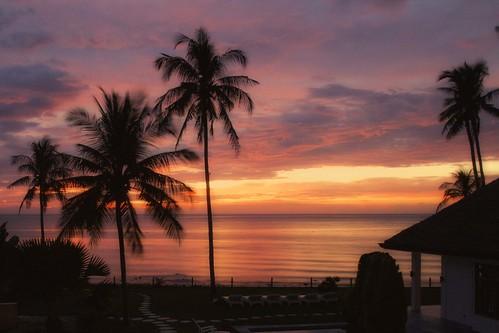 red sea sky sunrise palms island glowing dauin