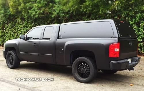 Satin black vinyl vehicle wrap by TechnoSigns