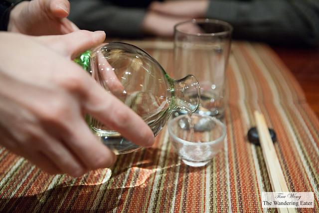 Pouring our carafe of Yoshinogawa Ginjo sake