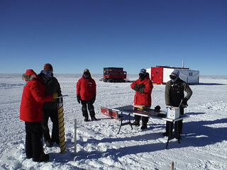Drilling one of six shallow cores at the drill site for snow density measurements   by U.S. Ice Drilling