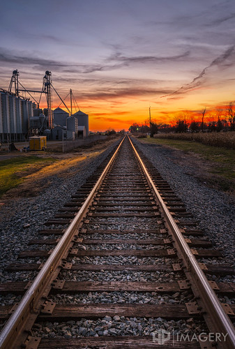 sunset tracks rr crossing landscape railroad silo sky track train
