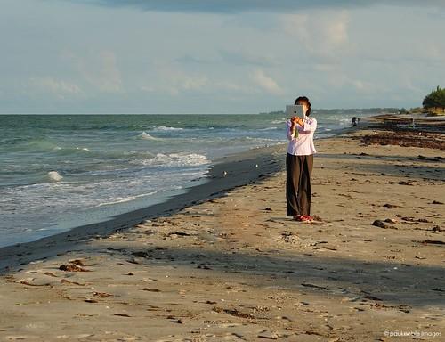 morning woman beach gulfofmexico water sunrise asian nikon florida explore longboatkey ipad d3000 sunriseonthebeach nikond3000 paulnobleimages takingaphotowithanipad asianwomanholdindanipad