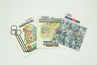"Sun, 11/23/2014 - 15:01 - 6.Early Ironman race programs (Feb '81, Feb 82, and October '83 shown here) listed every race entrant and their occupation. The program covers were the same art as the race posters. At some point, a few of the top competitors began disguising their (lack of) occupation. Paul Huddle was listed as a ""Lambada instructor"" and Tom Gallagher was noted as a ""Crossing Guard.""  Race Director, Valerie Silk didn't think the joke was very funny and began labeling most of the top athletes' occupation as ""professional athlete"" even though there was no prize money in the event. Dave Scott's occupation for years was listed as ""fitness consultant,"" which nobody understood because there wasn't much to consult on and certainly Dave wasn't offering any secrets back then."
