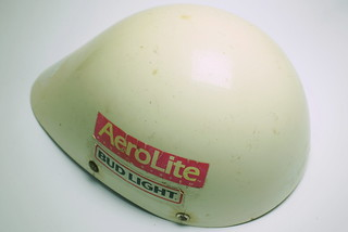 "Fri, 10/17/2014 - 14:55 - This aero helmet shell is the only piece of equipment I have left from my 1985 Ironman victory. Everything else, from my Swan goggles to my Tinley run visor were given away over the years. 1985 was the last year at Ironman where the only helmet requirement was that it be ""of a hard-shelled material and mass produced in that capacity."" This language was developed two years earlier when my brother, Jeff and I cut up the vertical blinds from our rented Kona condo and duct taped the plastic strips to the outside of our leather hair net helmets in an effort to find a faster, cooler, legal helmet. The only real protective value of a helmet such as this in a serious crash is that it might keep the brain matter from spilling over onto the street and traumatizing the passersby.  By Scott Tinley"