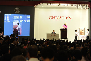 "The scene at Christie's Hong Kong as a Vietnamese painting sells for a record. Lot 10 a 1932 work by Nguyen Phan Chanh entitled ""La Marchande de Riz"" 