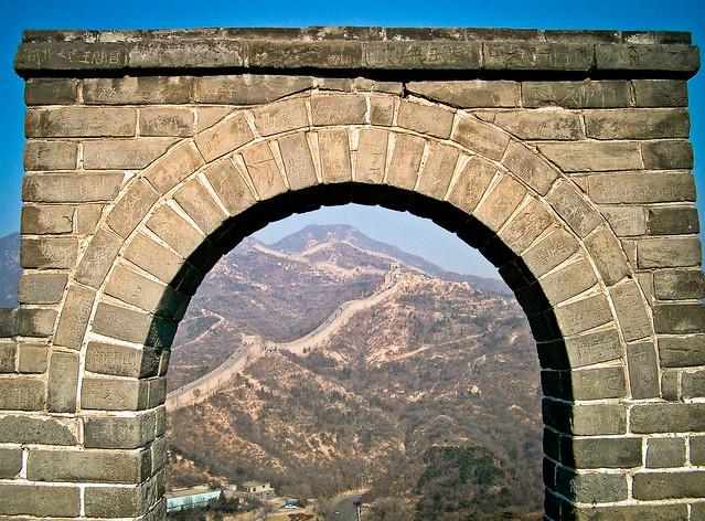 Wall through arch