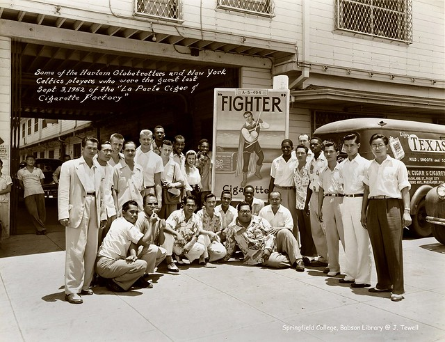 The Harlem Globetrotters and the New York Celtics at the La Perla Cigar and Cigarette Factory in Paranaque, Metro Manila, Philippines on September 3, 1952